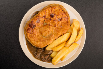 Beef Steak Pie With A Puff Pastry Crust Top And Chips