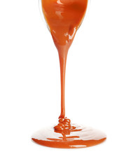 Delicious caramel sauce pouring on white background