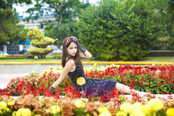 Beautiful young girl in a flower bed.