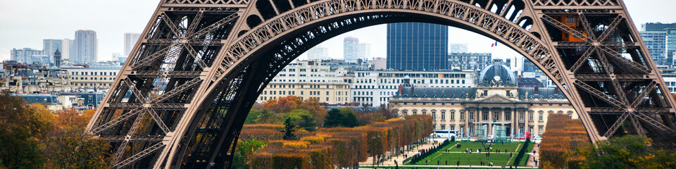 Eiffel Tower and Champ de Mars with people in Paris, France