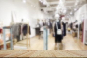 Empty top wooden table and blur with shop on blur background. For product display