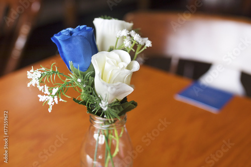 Close Up Of Blue And White Roses As A Table Decoration In A Small