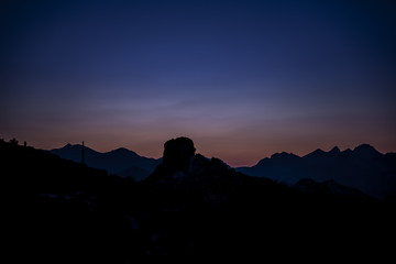 Silhouette Mountain after sunset with beautiful dark blue skies