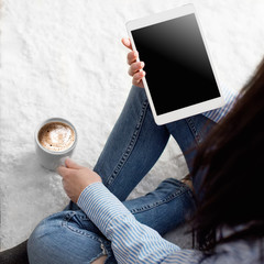 Woman on the floor with tablet
