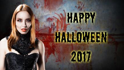 """Vampir vor blutiger Wand mit """"Happy Halloween 2017"""" Nachricht"""