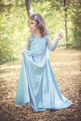 Portrait of beautiful little girl in blue dress