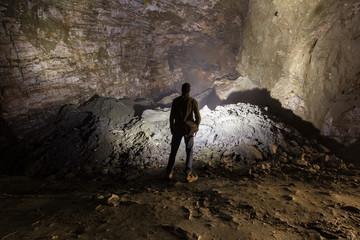 Miner in the underground quartz ore mine shaft tunnel