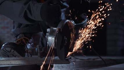Angle grinder producing sparks while cutting metal
