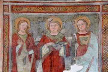 Sant'Apollonia, Santo Stefano e Santa Lucia; affresco nella chiesa di San Vigilio a Pinzolo