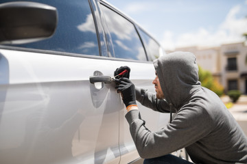 Forcing entry and stealing a car - fototapety na wymiar