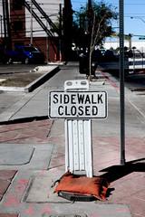 Sidewalk closed signs closing a sidewalk
