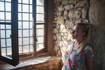 young blonde girl in the castle san leo italy