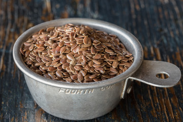 Brown Flaxseeds in vintage measuring spoon