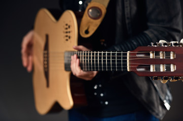 Musician holding the guitar