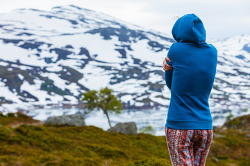 Tourist woman in mountains Norway