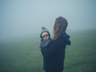 Mother with baby in the mist