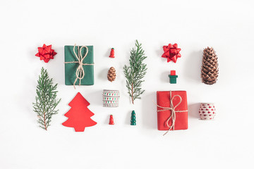 Christmas composition. Christmas gifts, pine branches, toys on white background. Flat lay, top view
