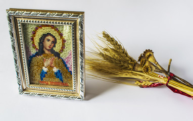 traditional Orthodox icon of Mary. Embroidered from beads. Nearby is a spikelet