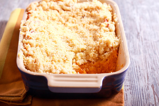 Pumpkin souffle dessert with crumble topping
