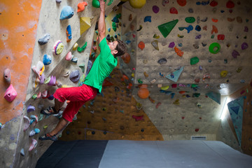 Climber trains at the climbing wall.