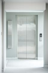 modern elevator made of metal in building