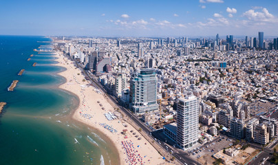 Tel Aviv skyline off the shore of the Mediterranean sea - Panoramic aerial image