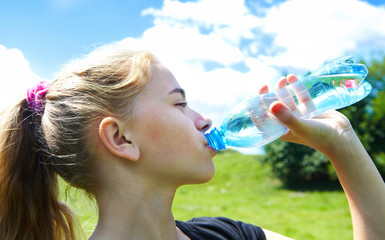 Young girl drink water