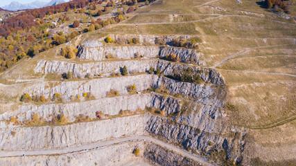 Drone aerial view of a concrete quarry closed to Linzone Mountain, Bergamo, Italy