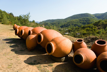 Large clay jugs for wine are put up for sale.