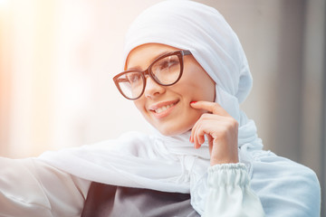 Portrait of beautiful woman wearing white scarf