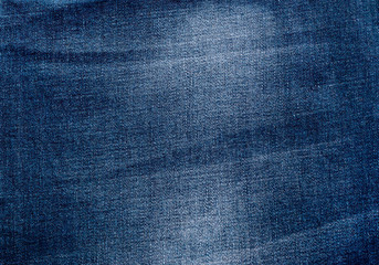 Texture of blue jeans. Abstract background. Top view.