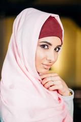 Portrait of a beautiful Muslim woman in cafe