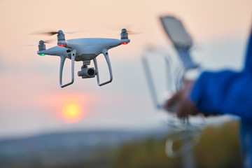 drone flying and operated by remote controlsunset
