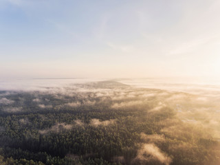 Early morning aerial view over city Druskininkai, Lithuania. City cover in summer fog clouds.