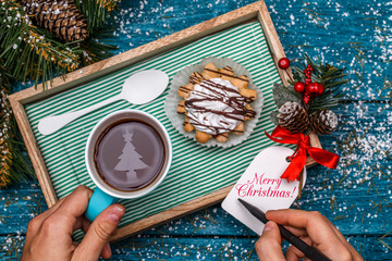 New Year's photo of tea with the image of Christmas tree, cake