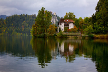 A manor in Lake Bled shore with autumn colors and reflection