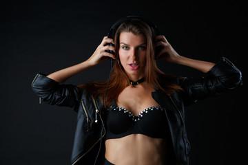 Studio photo of young girl in headphones, underwear