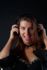 Image of happy girl in headphones with leather jacket