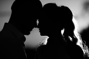 silhouettes of the young couple of the bride and groom