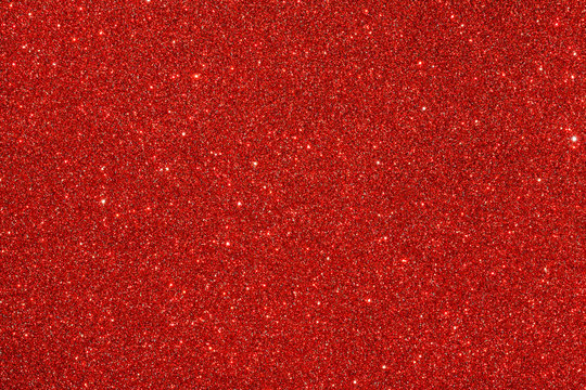 Red (ruby) glitter background. Sparkle texture. Abstract background for New Years or Christmas holiday