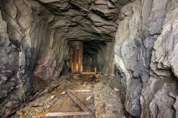 Underground abandoned mica ore mine shaft tunnel gallery passage