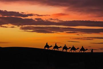 Foto op Canvas Marokko Morocco Merzouga Erg Chebbi sand dunes caravane sunset