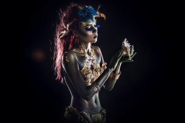 Foto op Aluminium Body Paint Woman beautiful model with body art unusual fancy in the Studio