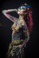 Woman beautiful model with body art unusual fancy in the Studio