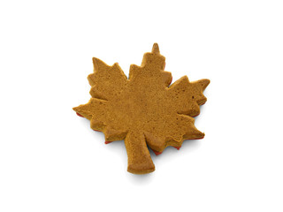 gingerbread baked in the form of a maple leaf isolated on white