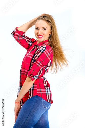 727ae94416e Young sexy woman dressed in jeans and checkered shirt posing in studio  isolated on white