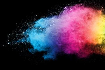 Splash of colorful powder over black background.