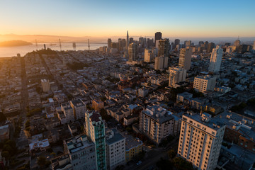 Aerial view of San Francisco at sunrise from above Russian Hill looking towards the Financial District and the bay