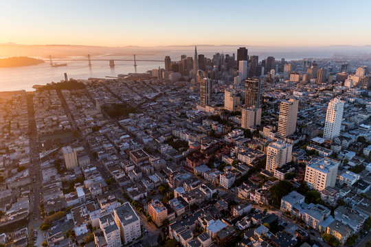 Dramatic aerial view of San Francisco at sunrise from Russian Hill looking towards the financial district.