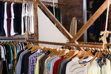 Different assortment of colorful clothing in  boutique